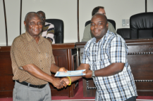 RMU lecturer and former ship captain J.K. Adjetey receives certificate from Ebenezer Nyadjro