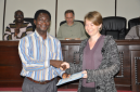 RMU lecturer Anthony Badu-Peprah (left) receives certificate of participation from Winn Johnson (right)