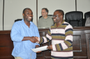RMU lecturer Francis Obeng (left) receives certificate of participation from Joseph Ansong (right)