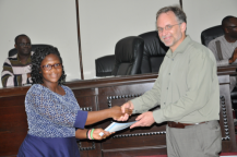 RMU lecturer Rebecca Kyerewa Essamuah receives certificate of participation from Brian Arbic