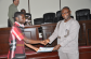 KUNST NIMS student Robert Acquah receives certificate of participation from Vice Chancellor Elvis Nyarko
